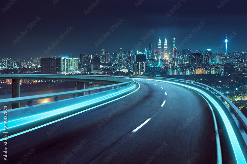 Fototapety, obrazy: Highway overpass motion blur with city background .night scene