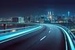 Leinwandbild Motiv Highway overpass motion blur with city background .night scene