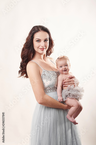 Fotobehang womenART young attractive mother with a little girl on a light background