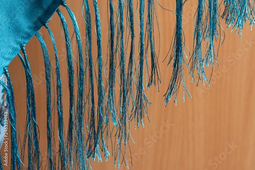 Fotografie, Obraz  Fringe of threads on wooden background