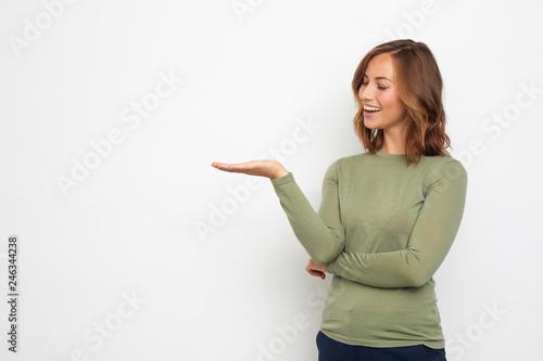 Fototapety, obrazy: young happy woman presenting your product on thie background