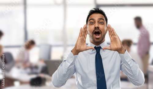 Photo  business, emotion and people concept - indian businessman shouting or calling ov