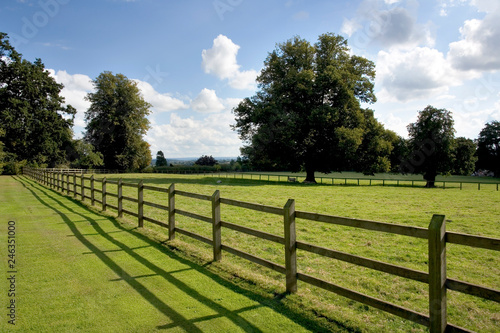 Fényképezés Post and rail fencing around a tidy paddock