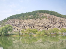 Luoyang Longmen Grottoes. Brok...