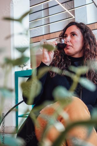 Cuadros en Lienzo Woman drinking a glass of sherry wine