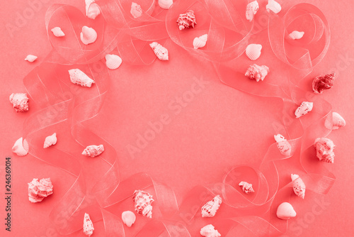 Different sea shells on live coral background Top view flat lay
