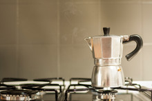 Steaming Moka Pot On The Kitchen Stove