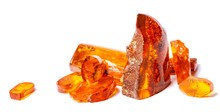 .Amber Crystals On A White Isolated Background