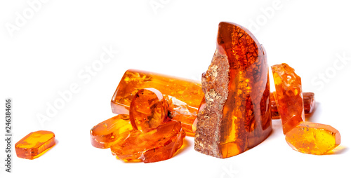 Photographie .Amber crystals on a white isolated background