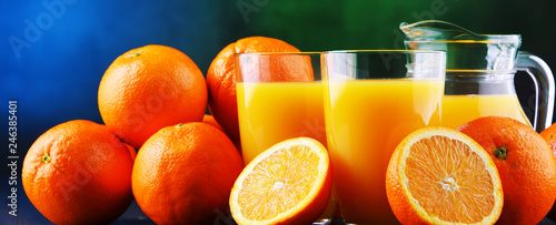 Fototapeta Glasses with freshly squeezed orange juice obraz na płótnie