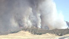 Huge Smoke Plume And Fire Burning In Placeria Canyon Sand Fire