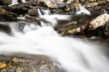 Waterfall In Mountains. Rapid Flow In River. Water In Rocks, Trip Along River.