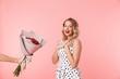 Leinwanddruck Bild - Beautiful young blonde woman wearing dress standing