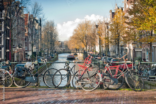 Foto op Canvas Kanaal Scenic of bridge with bicycles parked over the canals of Amsterdam, Netherlands.