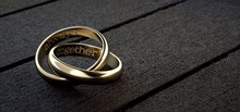 Two Wedding Rings Intertwined ...