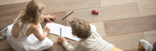 Horizontal Top Above Photo Little Children Preschool Brother Sister Drawing On Warm Wooden Floor Play Spend Free Time At Modern Home Together, Banner For Website Header Design With Copy Space For Text