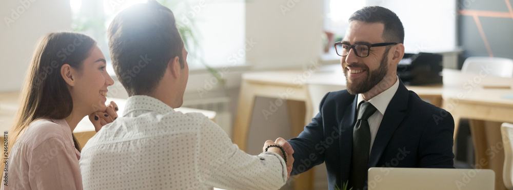 Fotografie, Obraz Confident real estate agent financial advisor in suit shaking hands with client