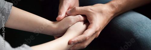 Fotografering  Close up man woman holds hands couple reconcile make peace after quarrel show ca