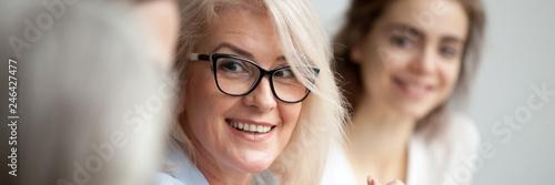 Fotografiet  Horizontal close up photo focus aged attractive businesswoman boss in glasses li