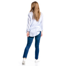 Woman In Jeans And Blue Shirt Goes On White Background Isolation, Top View