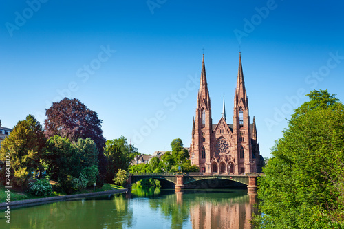 Ill river bank and Saint Paul Church in Strasbourg