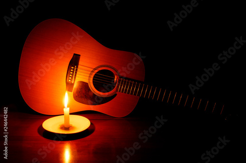 Guitar with Candle Glow - 246442482