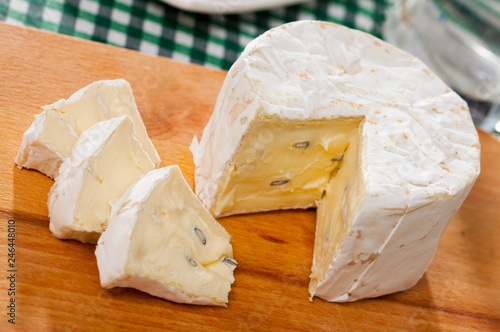 Slices of cambozola cheese on desk, dish of french cuisine