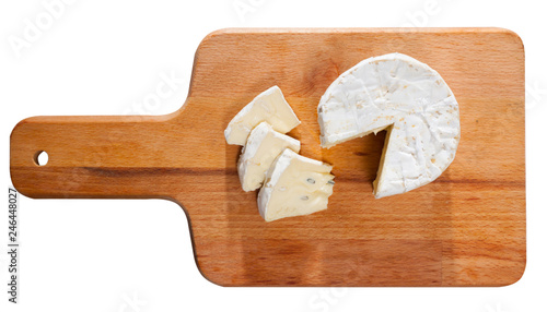 Tasty slices of french cambozola cheese at wooden desk