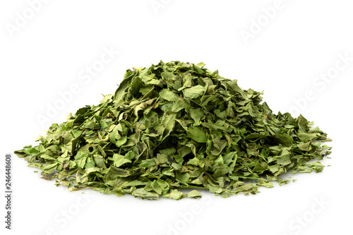 A pile of dried chopped coriander leaves isolated on white. Wallpaper Mural