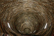 A picture of a tunnel made of books. Looking quite hypnotic. It is made of books and mirrors.