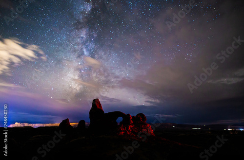Spoed Foto op Canvas Lavendel Milky Way breaking through clouds over Turret Arch, Arches National Park