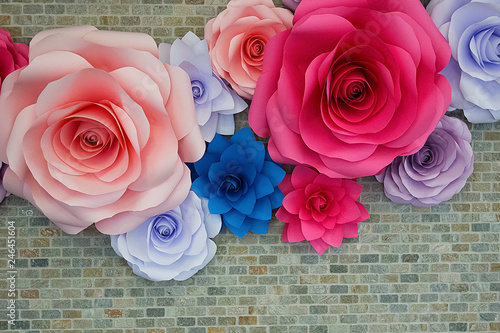 Photo  Decorative paper multicolored flowers on a gray wall.