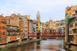 Colorful houses and Eiffel bridge on river Onyar in Girona