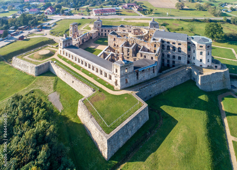 Fototapeta Old, ruined castle Krzyztopor in Ujazd, Poland, built in 17th century, ruined to naked walls in 18th century. Aerial view in the morning
