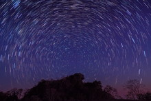 Night Photography Of Star-Trails Above Doi Hua Singh Top Of Doi Samur Dao, Sri Nan National Park, Nan, Thailand.