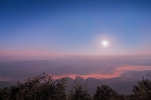 Night Photography Of Moon Rising Above Sea Of Mist And Mountains, Doi Samur Dao, Sri Nan National Park, Nan Province, Northern Of Thailand.