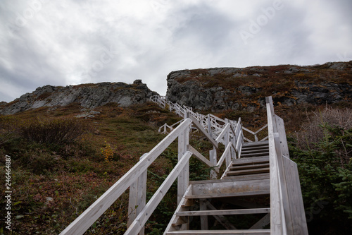 Wooden stairs going up a rocky cliff on the Atlantic Ocean Coast during a cloudy day Canvas Print