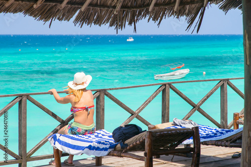 silhouette of woman looking to sea in summer day on tropical island