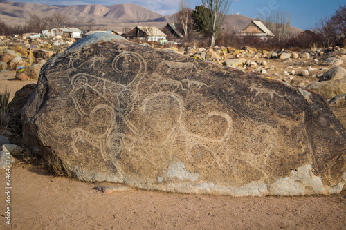 Kyrgyzstan - Issk-Kul - Cholpon-Ata - The boulder with picked stone age rock art Canvas Print