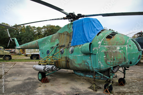 Photo A picture from the old abandoned military airbase in Czech republic, full of old rusty planes and helicopters