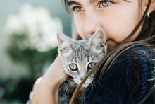 Portrait Of Child With Kitten