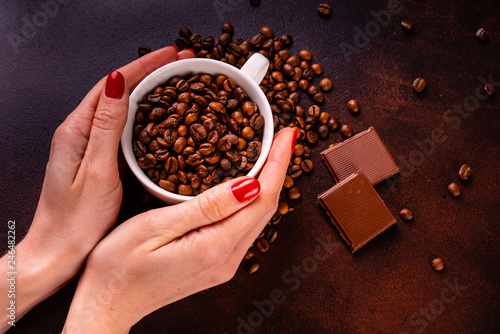 Photo Stands Cafe Seeds of fragrant coffee, coffee drink on a dark concrete background. It can be used as a background
