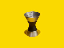 Double Jigger Cocktail Measure On A Yellow Background