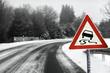 Leinwanddruck Bild - Snowy curvy road with traffic sign