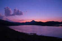 Twilight Sky River Sunset Purple Color Landscape Lake Evening Time Clouds And Mountains Background