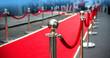 Leinwanddruck Bild - red carpet and barrier on entrance