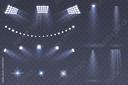 Obraz Vector Stadium spotlights. Scene spotlights set isolated on transparent background. Bright illumination. light sources for your design. Glowing stars. Eps 10. - fototapety do salonu