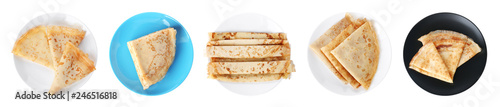 Set of plates with tasty thin pancakes on white background, top view