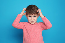 Little Boy Scratching Head On Color Background. Annoying Itch
