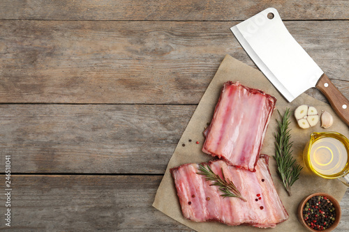 In de dag Aromatische Flat lay composition with raw ribs, products and space for text on wooden background. Fresh meat